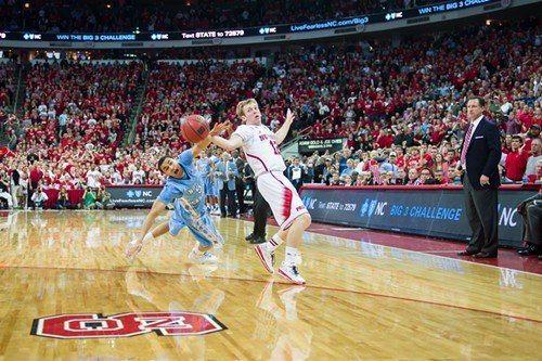 UNC guard Marcus Paige vies with N.C. State guard Tyler Lewis, PNC Arena, February 26, 2014