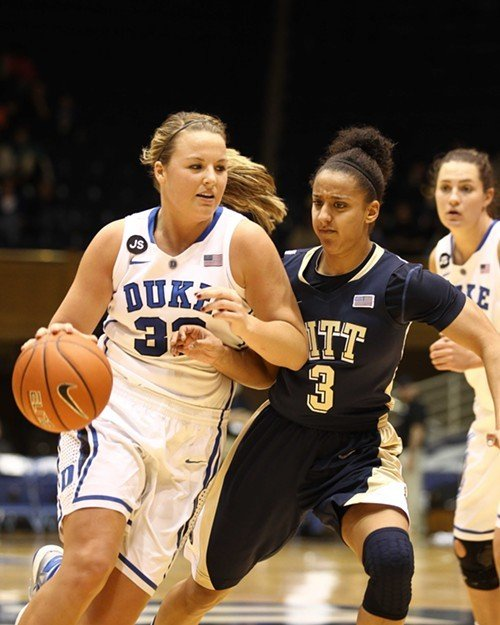 Tricia Liston drives to the hoop as Pitt's Briana Kiesel defends. Haley Peters is at right.
