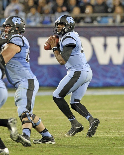 Marquise Williams looks for a receiver as Caleb Peterson provides protection.