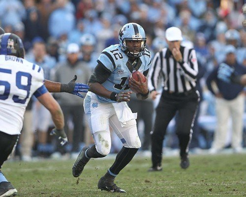 UNC QB Marquise Williams looks for running room. Dukes No. 59 is Kelby Brown.