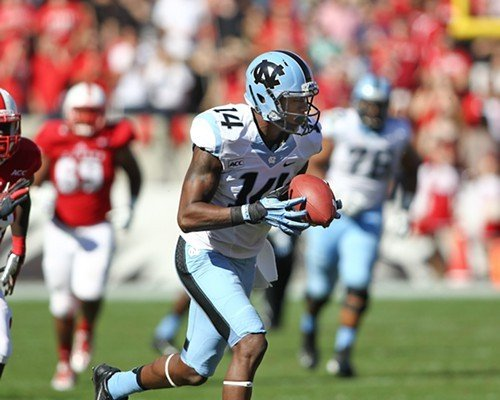 UNCs Quinshad Davis runs in the open field after a catch.