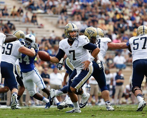 Pitt QB Tom Savage looks for an opening as his huge linemen — no starter weighs under 300 — block for him.