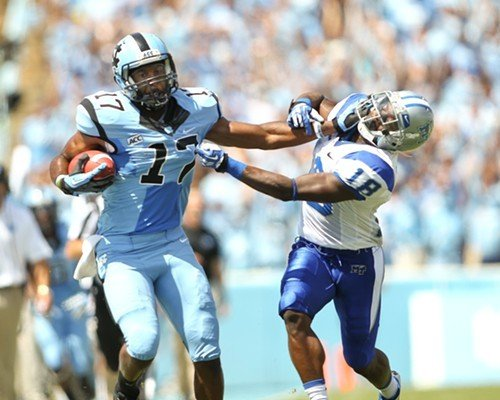 UNC wide receiver Mark McNeill gives a stiff arm to the Blue Raiders' Kenneth Gilstrap.