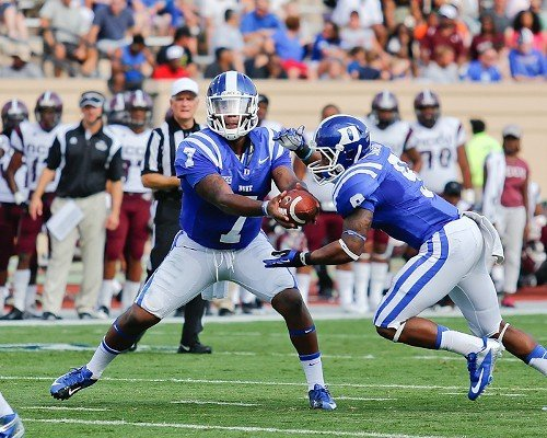 Duke's Anthony Boone hands off to Josh Snead.