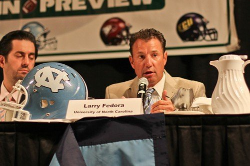 UNC coach Larry Fedora answers a question.