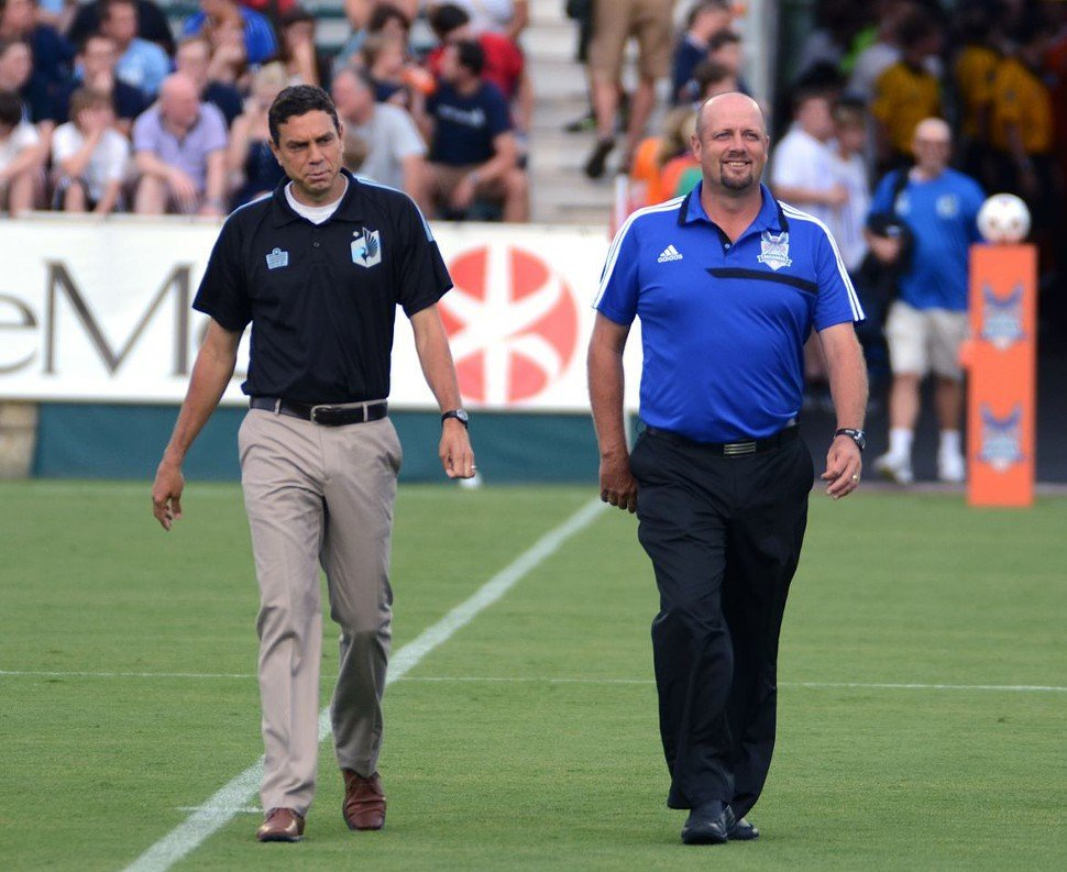 RailHawks manager Colin Clarke and Minnesota United manager Manny Lagos stroll the sidelines prior to their match Saturday at WakeMed Soccer Park