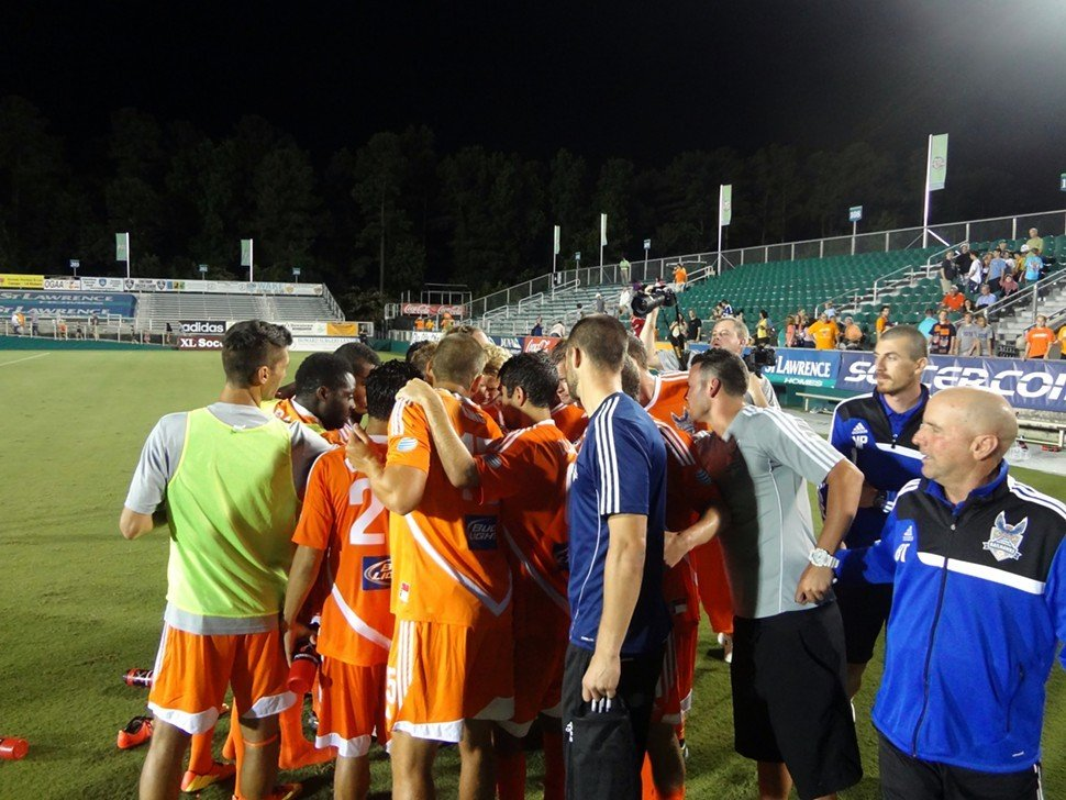 The victorious RailHawks huddle after their 3-2 win over Minnesota United FC Saturday night in Cary