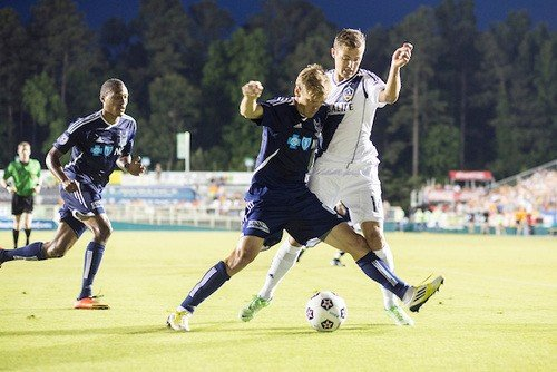 Robbie Rogers (right) battles the RailHawks Floyd Franks.