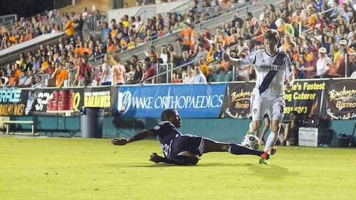 The Galaxy were unable to break down the RailHawks defense. Here, Jordan Graye tackles Greg Cochrane.