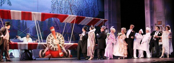 Just dropping in: Trix the aviatrix (Yolanda Rabun) crashes the wedding party in THE DROWSY CHAPERONE