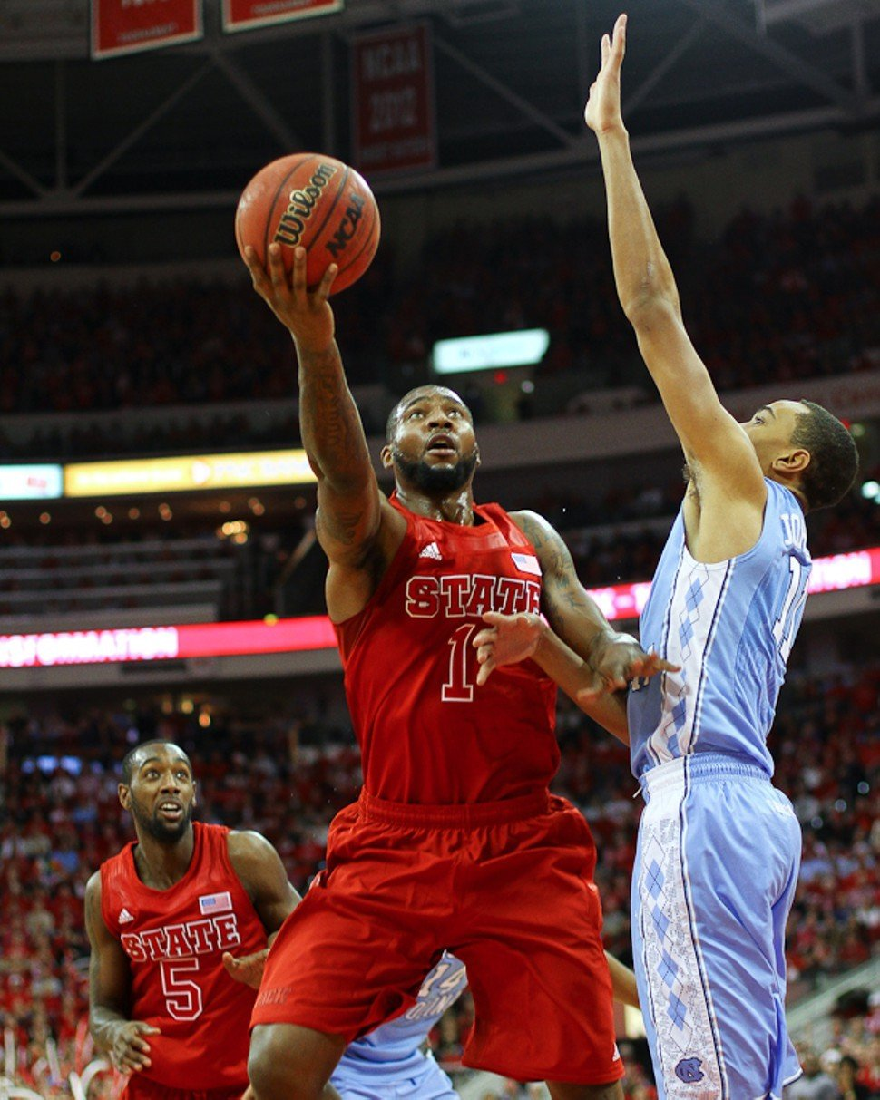 Richard Howell rises over Brice Johnson during N.C. States 91-83 win over North Carolina in Raleigh, N.C.