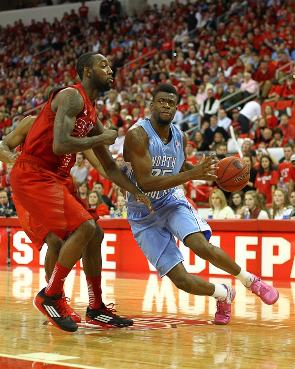 UNCs Reggie Bullock drives on N.C. States C.J. Leslie