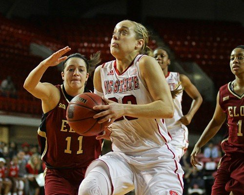 Marissa Kastanek drives for the hoop as Elon's Ali Ford defends.