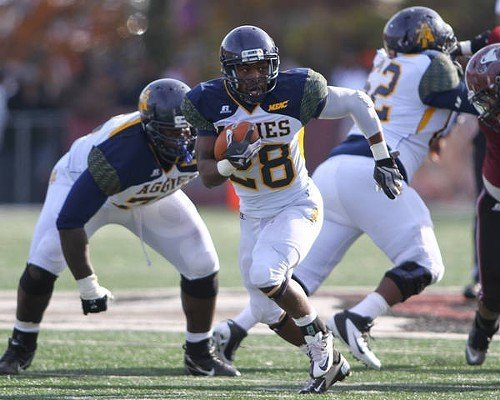 A&Ts Mike Mayhew picks up yardage after finding a big hole.