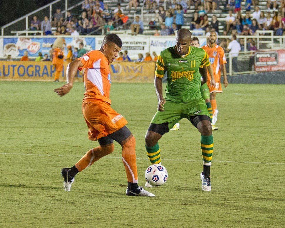Amir Lowery of the Carolina RailHawks faces off with Rowdies midfielder Shane Hill on Sept. 22 in Cary, N.C.