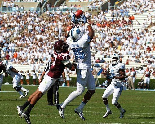 UNCs Eric Ebron hauls in a pass in front of Virginia Techs Kyle Fuller.