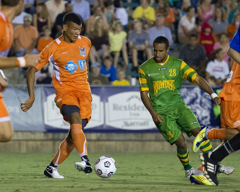 Amir Lowery of the Carolina RailHawks maneuvers around the Rowdies Raphael Cox during Saturdays 0-0 draw in Cary