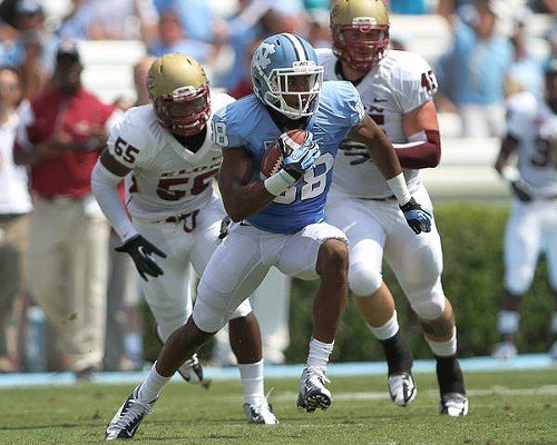 UNCs Erik Highsmith runs for daylight in the Elon game.