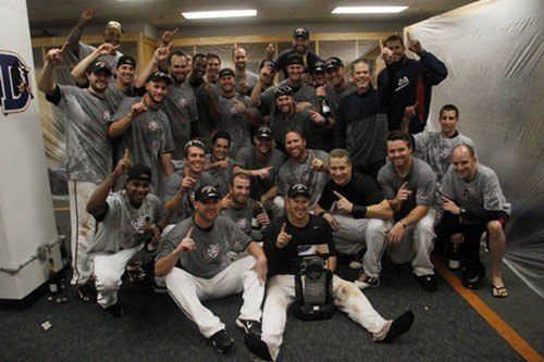 The Reno Aces pose for a team photo in their champagne-soaked clubhouse.