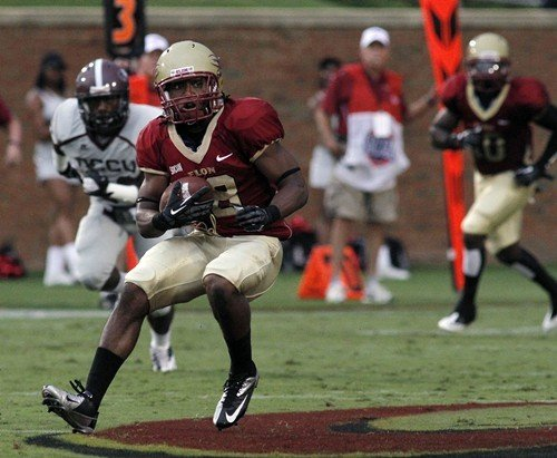 Elons Jeremy Peterson looks for running room against NCCU.