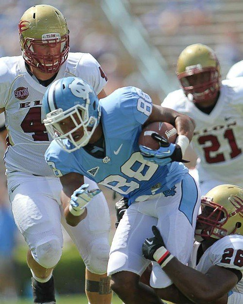 UNCs Erik Highsmith fights for yardage in the Elon game.