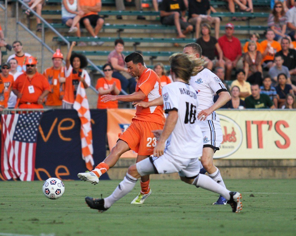 Nick Zimmerman slots home a first-half goal during the Carolina RailHawks 3-2 win over FC Edmonton at WakeMed Soccer Park