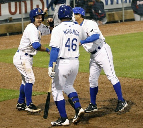 The Bulls celebrate after Will Rhymes (L) scored the winning run in the 12th inning last night.