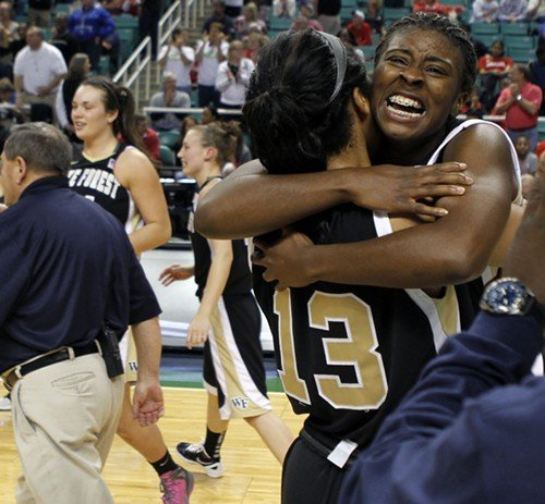 Wakes Lakevia Boykin gets a hug from teammate Mykala Walker (13) after the upset of Miami.