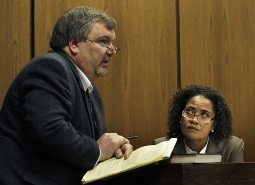 Lawyer Stephen Lindsay, left, questions suspended Durham District Attorney Tracey Cline on the witness stand.