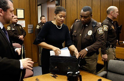 Suspended Durham District Attorney Tracey Cline packs her files after an hour-long hearing on whether she should be removed from office. A judge granted Cline, who is recovering from pneumonia, a continuance to Feb. 20.