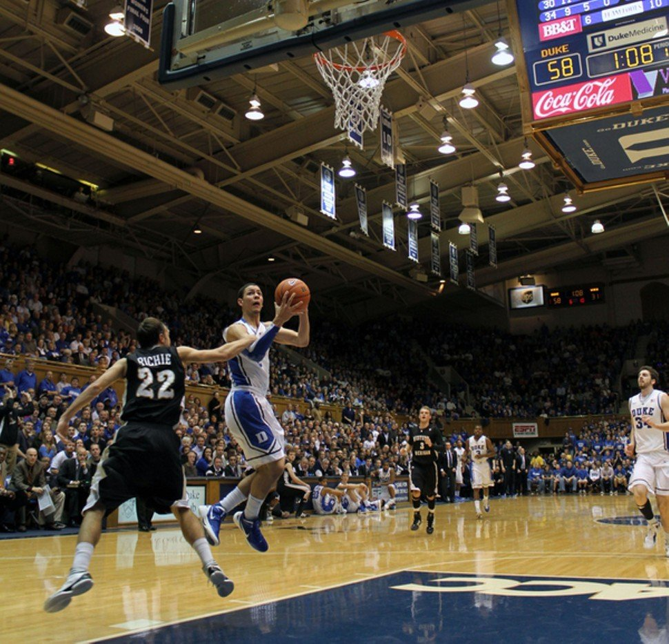 Western Michigan tried to slow Duke with physical play, including this foul by Austin Richie on Austin Rivers, with the score 58-31.