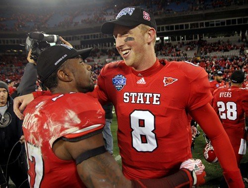 NC State quarterback Mike Glennon hugs Earl Wolff afer defeating Louisville.