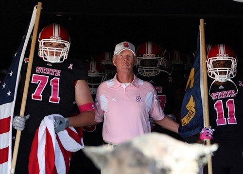 N.C. State Coach Tom OBrien prepares to lead his team onto the field in a game earlier this season.