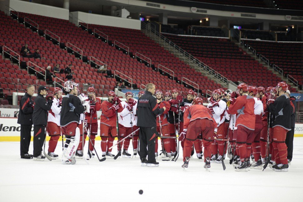 Coach Paul Maurice (center) gathers the Canes at a preseason practice? Will someone else be standing at the center of this picture soon?
