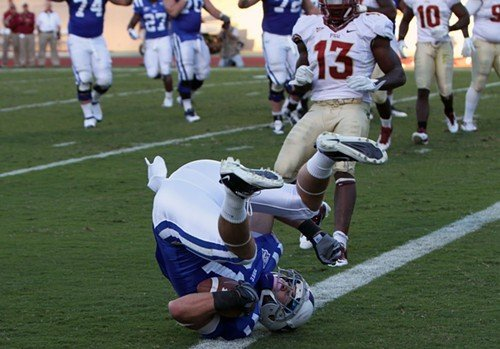 Tight end Cooper Helfet does a flip as he scores a touchdown for the Blue Devils in the fourth quarter.