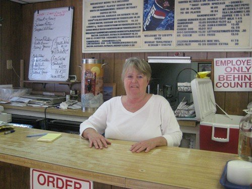 Libby Green of Libbys Too behind the counter at her Durham restaurant.