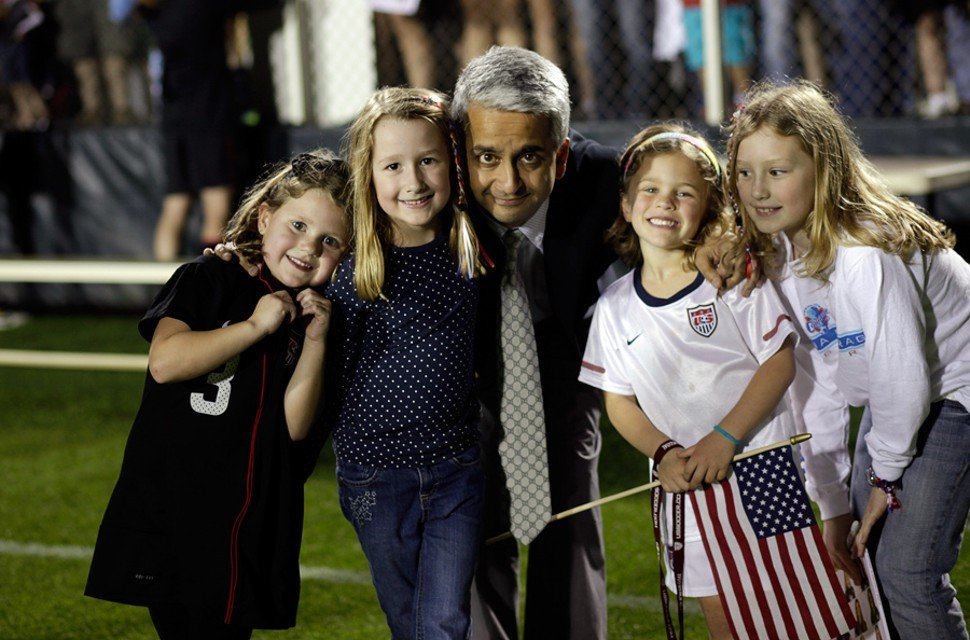 Sunil Gulati, president of the U.S. Soccer Federation, poses with prospects.