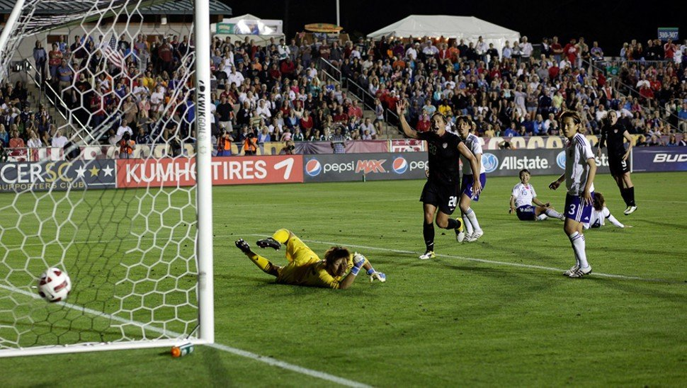 Heather OReilly (rear, No. 9) watches her shot go in the net as Abby Wambach, foreground, watches.