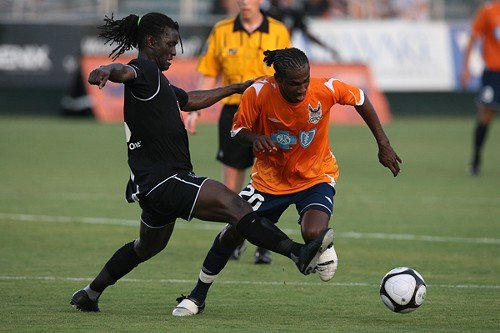 Gregory Richardson of the RailHawks fights past a Cleveland player in 2009.