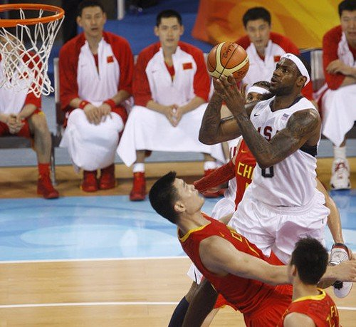 Lebron James runs over Yao Ming during the 2008 Olympics.