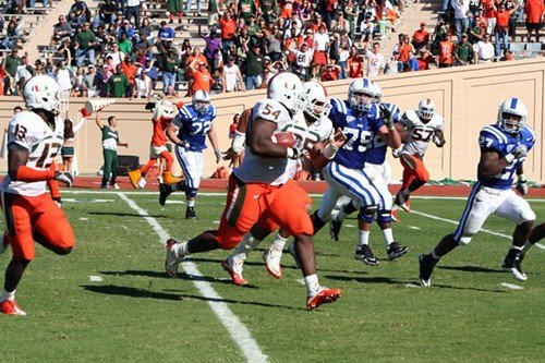 Miamis 305 pound Defensive Lineman Micanor Regis runs for a touchdown after intercepting Sean Renfrees pass.