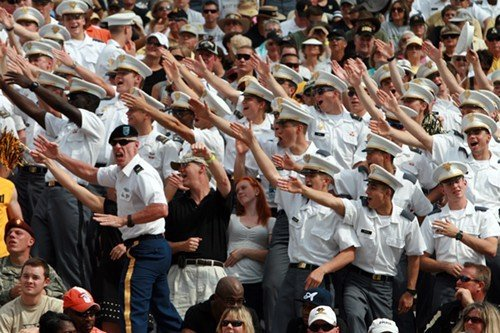 West Point cadets celebrate a touchdown during the first half.