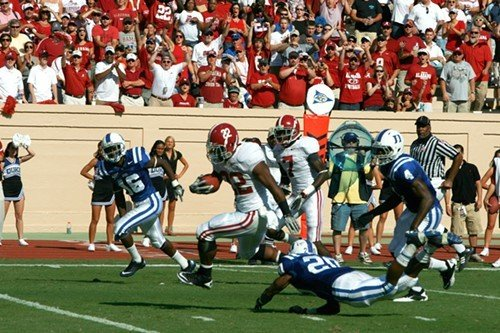 Alabama's 2009 Heisman Trophy winner Mark Ingram escapes Dukes Lee Butler (20) while Chris Rwabukamba (16) gives chase.