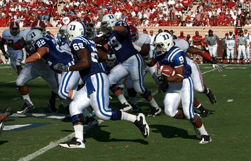 Duke freshman running back Josh Snead (9) follows a block from Bryan Morgan (62)