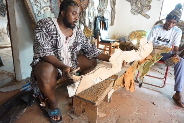 JMD working on sculpture Mudiki Studio.JPG