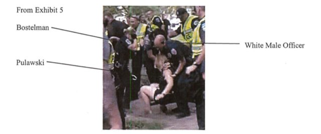 Video still showing different officer taking Pulawski down.png