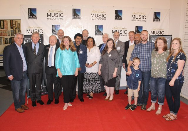 NCMHOF-Board-of-Directors-with-Susi-Hamilton-and-Family-of-Doc-Watson-1.jpg