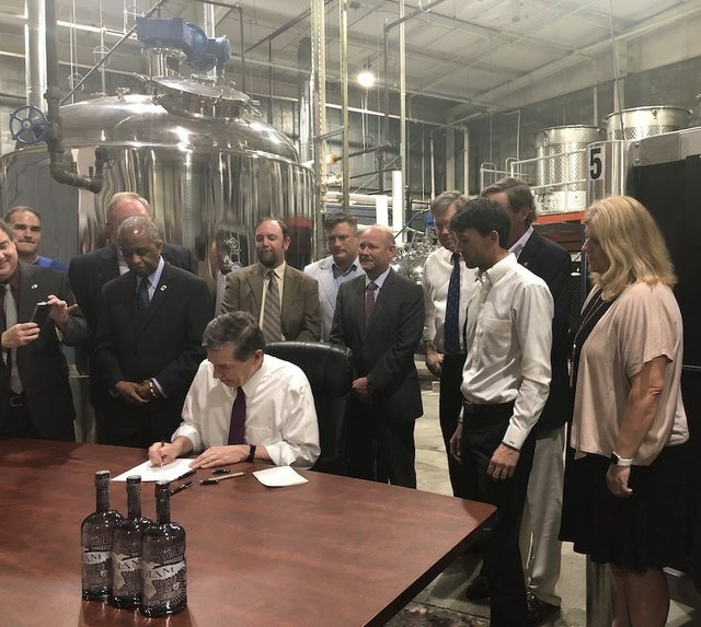 governor-cooper-signed-SB-290-distilleries.jpg