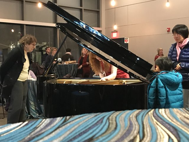Sarah Cahill preparing piano.jpg