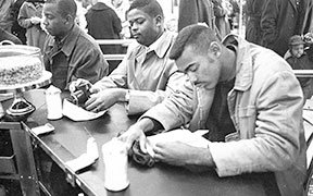 Civil_Rights_protesters_and_Woolworth's_Sit-In,_Durham,_NC,_10_February_1960-1._From_the_N&O_Negative_Collection,_State_Archives_of_North_Carolina,_Raleigh,_NC._Photos_taken_by_The_News_&_(24495308926).jpg